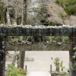 Torii gate with stones on top — Stock Photo