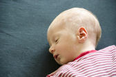 Cute baby lying on its back — Stock Photo