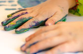 Child painting with hands — Stock Photo