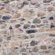Old field stone wall background — Stock Photo