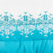 Embroidered white snowflakes — Stock Photo
