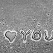 Inscription I love you written on a black background with water — Stock Photo #16189607