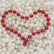 Stock Photo: Red beads in shape of heart