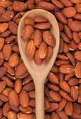 Wooden spoon with almonds — Stock Photo