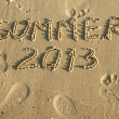 Royalty-Free Stock Photo: Word summer written by in the sand