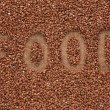 "Word to  ""food"" write  buckwheat groats on sacking — Stock Photo"