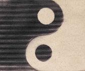 Yin-yang symbol on the sand — Stok fotoğraf