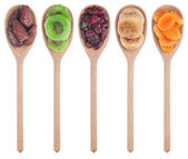 Wooden spoon with dried apricots, figs, dates, kiwi and cranberr — Stock Photo
