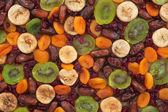 Dried apricots, kiwi, figs, dates, cranberries on sackcloth — Stock Photo