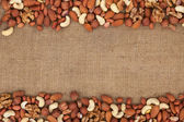 Mixture of nuts lying on sackcloth — Stock Photo