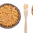 Corn in a plate, fork and spoon — Stock Photo