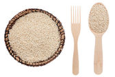 Sesame in a plate, fork and spoon — Stock Photo
