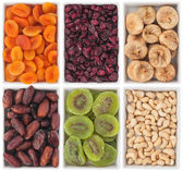 Nuts and dried fruits in ceramic plate — Stock Photo