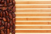Dried dates lying on a bamboo mat — Stockfoto