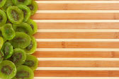 Dried kiwi lying on a bamboo mat — Stock Photo