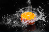 Water poured on an orange — Stock Photo