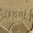 Word summer written by in the sand — Stock Photo #29933991