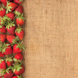 Stock Photo: Strawberries lies on sackcloth