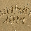 The word summer written on the sand — Stock Photo