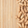 Peeled almonds lying on a bamboo mat — Stock Photo #30269155