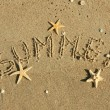 Word summer written by in the sand — Stock Photo