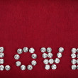 Inscription love laid out with rhinestones — Stock Photo #30604133
