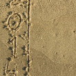 Word 2014 written by in the sand — Stock Photo