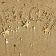 Word welcome written on the sand — Stock Photo