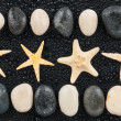 Zen stones and starfish with water drops — Stock Photo