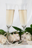 Rings, rose and two champagne glass — Stock Photo