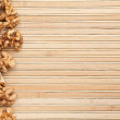 Walnut is on a bamboo mat — Stock Photo