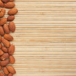 Almond is on a bamboo mat — Stock Photo