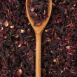 Wooden spoon with dried hibiscus — Stock Photo