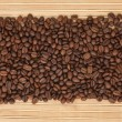 Stock Photo: Coffee beans lying on bamboo mat