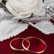 Wedding rings on a red cloth — ストック写真