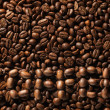 The word coffee laid out on the background from coffee beans — Stock Photo