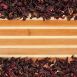 Dried hibiscus on a bamboo mat — Stock fotografie