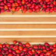 Rosehip on a bamboo mat — Stock fotografie