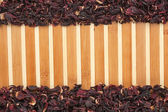 Dried hibiscus on a bamboo mat — Stock Photo