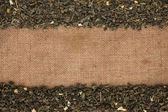 Green tea  were lying on sackcloth — Stock Photo