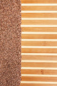 Flax seed  on a bamboo mat — Stock Photo