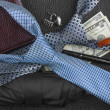 Tie, umbrella, wallet, pen, cufflinks, money lying on the skin, — Stock Photo