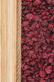 Cranberries, mat and rope for the menu — Stock Photo