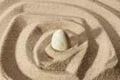 White stone sticking out of the sand — Stock Photo
