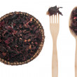 Dried hibiscus in a plate, fork and spoon — Stock Photo #49082299