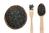 Sunflower seeds in a plate, fork and spoon — 图库照片