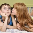 Stock Photo: Girl kissing boy on cheek