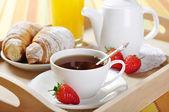 Tea and croissants — Stock Photo
