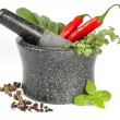 Granite mortar with fresh herbs — Stock Photo