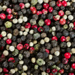 Stock Photo: Mixed red, white and black pepper corn seeds